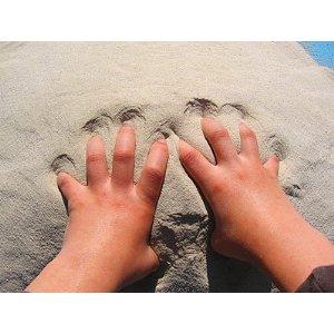 Sand mit Händen